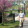 David Ewing, of New Albany, exercises on the walking trail on a section of the Ohio River Greenway in New Albany on Wednesday morning. Staff photo by Christopher Fryer