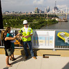 Joel Halterman, a project manager with Walsh Construction, discusses the details of the new Interstate 65 bridge foundation work with members of the media on the Big Four Bridge above the Ohio River on Thursday morning. Staff photo by Christopher Fryer