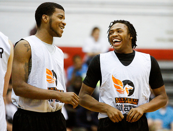 Indiana University recruits Jeremy Hollowell, left, and Ron Patterson, joke around while waiting to compete in the slam-dunk competition at the Night of Future Stars in the gym at New Albany High School on Thursday evening. Staff photo by Christopher Fryer