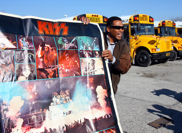 Greater Clark County Schools director of transportation Milt Clayton holds a KISS poster that was included in a 1979 time capsule opened Wednesday. The capsule was buried by students in the Jeffersonville Alternative School, now Corden Porter, when Clayton was principal there. Staff photo by C.E. Branham