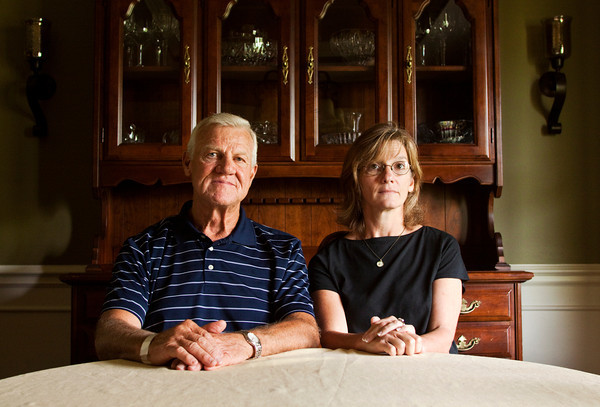 Sam Lockhart, Greenville, and his niece Julie Blankenbaker, Louisville, sit in Lockhart's home on Thursday morning. Lockhart's nephew and Blankenbaker's brother, David Camm, is accused of killing his wife, Kimberly, and their two children, Bradley, 7, and Jill, 5, in Georgetown on Sept. 28, 2000. Staff photo by Christopher Fryer