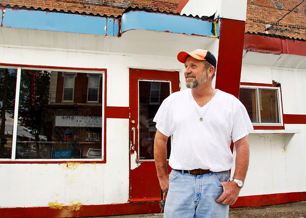Mike Scott stands in front of the 1957 prefabricated restaurant at the corner of Market and Bank streets in downtown New Albany on Friday afternoon. Scott is remodeling the restaurant with plans to re-open it as a hot dog and ice cream stop. Staff photo by Christopher Fryer