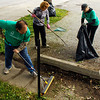 From left, John Gonder, of New Albany, Denise Wright, of Jeffersonville, and Erin Elrod, of New Albany, work on cleaning up the lot at the corner of Pearl and Spring streets as part of City Beautification Day in downtown New Albany on Saturday morning. Keep New Albany Clean & Green, Develop New Albany and MainSource Bank teamed up to sponsor the cleanup effort with more than 50 volunteers working on various projects around the city. Staff photo by Christopher Fryer