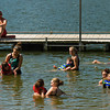 Camp Riley counselors assist campers in the swimming area of the lake at Indiana University's Bradford Woods near Martinsville on Tuesday morning. Staff photo by Christopher Fryer