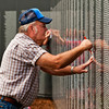 Earl Harris, of Marengo, makes a rubbing of his wife Helen's cousin's name at the American Veterans Traveling Tribute Vietnam Wall next to the Clarksville Municipal Center along Veterans Parkway on Thursday afternoon. Staff photo by Christopher Fryer