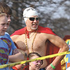 Philip Hoskins faces the judges in the costume contest portion of the 2012 Polar Plunge at Deam Lake on Saturday.  Staff photo by C.E. Branham