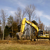Terry Hubert, of Clark Nickles, Inc. out of Charlestown, uses an excavator to clear trees and other foliage from the future site of the Timber Lodge student dormitory at Indiana University Southeast on Wednesday afternoon. The dorm will be the school's sixth residence hall and is scheduled to be completed around July 2014. Staff photo by Christopher Fryer