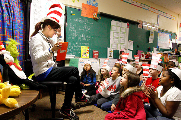 "Jessica Knable, New Albany-Floyd County Consolidated School Corp. board member, reads ""Green Eggs and Ham"" by Dr. Suess to a class or third-graders at Mount Tabor Elementary School in New Albany on Friday. Knable read the book as part of Read Across America week, but also as a kickoff to ISTEP+ testing, which begins March 4. Staff photo by Jerod Clapp"