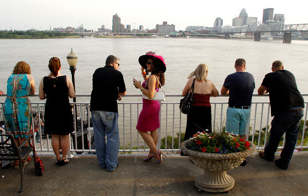 Party attendants watch from the upper deck as the Louisville Crashers cover rock songs during the annual Mudd Sisters Steamboat Race Party at the Kingfish Restaurant in Jeffersonville on Wednesday evening. The event is held as a benefit to raise funds for Alzheimer's disease research and services. Staff photo by Christopher Fryer