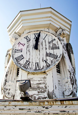 The weather-worn clock tower of the Second Baptist Church sits on top of the aging structure in downtown New Albany on Wednesday morning. A crane was used to do a structural analysis for possible restorations on the historic building that was erected in the mid-nineteenth century. Staff photo by Christopher Fryer