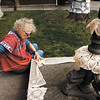 Linda Theede, of New Middletown, crochets vintage doilies together as part of a crochet bombing at the Carnegie Center for Art and History in New Albany on Wednesday afternoon. Theede and other fiber artists gathered at the Carnegie Center to cover trees, lampposts, urns, and other outdoor features in front of the building as an extension of Bette Levy's fine-art-embroidery show Tools of the Trade, which opened Friday and runs through April 28th. Staff photo by Christopher Fryer