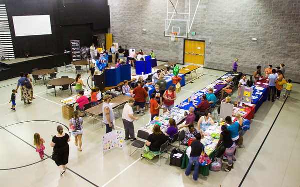 Attendants move between vendors and booths set up in the gymnasium at Eastside Christian Church during their second annual Community Health, Education and Safety Fair in Jeffersonville on Saturday morning. Staff photo by Christopher Fryer