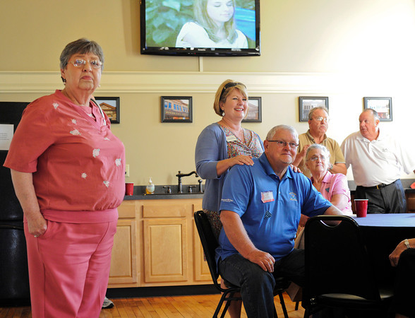 Floyd County Treasurer Linda Berger, left, Floyd County Recorder Lois Endris, center, and her husband Mike Endris look on as primary election results come in at the River City Winery in downtown New Albany on Tuesday night. Staff photo by Christopher Fryer