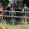 Investigators dig in the back yard of William Clyde Gibson, who is charged with the murders of two women, on Monday on Woodbourne Drive in New Albany. Cadaver dogs located two spots in Gibson's back yard where bodies may have been. Staff photo by Jerod Clapp