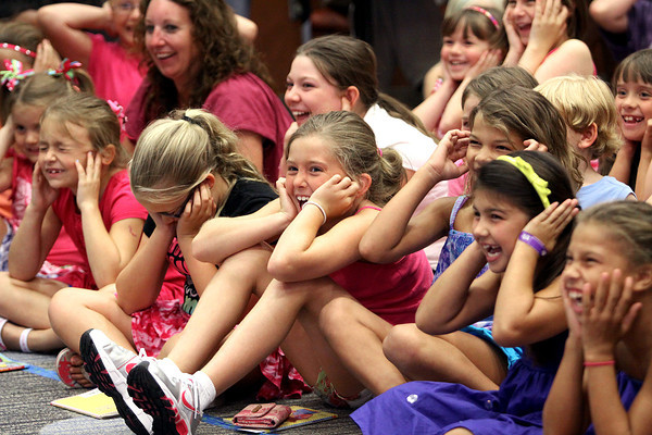 Children cover their ears as Junie B. Jones plays cymbals during the Junie B. Jones Stupid Smelly Bus Tour performance Monday at the Jeffersonville Township Public Library. Staff photo by C.E. Branham