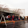 Clark and Floyd county residents wait in line to pick up toys, clothing and food items through the Angel Tree and other holiday assistance programs at the Salvation Army in New Albany on Saturday afternoon. Staff photo by Christopher Fryer