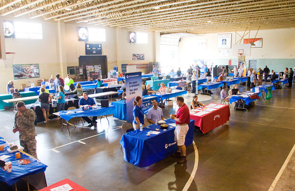 Attendants move between the booths of 48 vendors from Indiana and Kentucky during the Ohio River Bridges Project Job Fair at the Indiana National Guard Armory in New Albany on Tuesday afternoon. Staff photo by Christopher Fryer