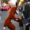 Rudolph visits with a young parade viewer during the Light Up the Holiday Parade Saturday evening in downtown Jeffersonville. Staff photo by C.E. Branham