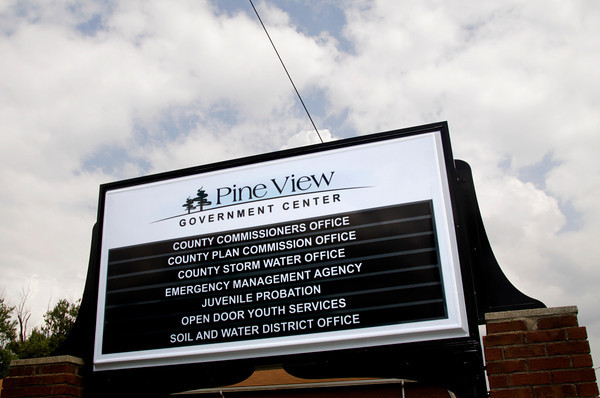 The sign for the recently opened Pine View Government Center sits at the entrance to the facility along Corydon Pike in New Albany on Tuesday afternoon. Staff photo by Christopher Fryer