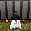 U.S. Army veteran Jim Floore, of Sellersburg, looks for the name of Robert Ufford while visiting the American Veterans Traveling Tribute Vietnam Wall next to the Clarksville Municipal Center along Veterans Parkway on Thursday afternoon. Floore eventually found his friend's name and went on to look for the names of others that he served with during the Vietnam War. The 80-percent scale replica of the Vietnam Veterans Memorial in Washington D.C. will be on display 24 hours a day through September 16. Staff photo by Christopher Fryer