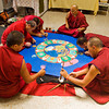 Tibetan monks work to complete a World Peace sand mandala at the Carnegie Center in New Albany on Thursday afternoon. Seven monks from the Labrang Tashi Kyil Monastery in Dehradun, India worked on the project that took days to complete. Staff photo by Christopher Fryer
