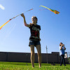 Katie Miller, 15, left, and Hannah Fetz, 15, both of New Albany, work on getting their new kites airborne at Bicknell Park in New Albany on Thursday afternoon. Staff photo by Christopher Fryer