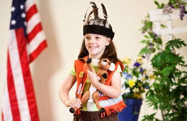 Lillie Smitson, 5, of Charlestown, models a costume that was sewn by her grandmother for the Sewing for Others/Children's Garments category of the Clark County Extension Homemakers Showcase of Fashions that was held in the Community Building at the Clark County Fairgrounds on Saturday afternoon. Staff photo by Christopher Fryer