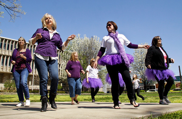 The Southern Indiana Shufflers dance in Warder Park during the Paint Our Town Purple event to raise awareness for the American Cancer Society's Relay for Life of Clak County on Saturday afternoon in downtown Jeffersonville. Relay For Life of Clark County will be held May 17 at Charlestown High School. All proceeds raised during Paint Our Town Purple and Relay For Life will benefit the American Cancer Society. For more information, call 1-800-227-2345 or visit relayforlife.org/clarkin or cancer.org. Staff photo by Christopher Fryer