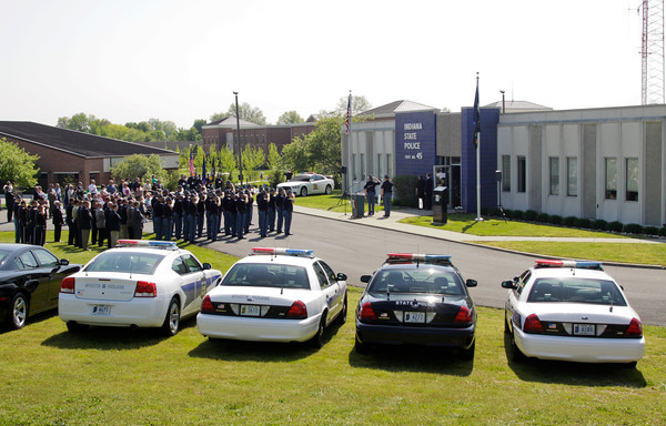 Troopers stand in formation in front of Post No. 45 in Sellersburg during the annual Indiana State Police Sellersburg District memorial service for the 46 personnel members that have died while serving Indiana since 1933. Staff photo by Christopher Fryer