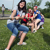 Morgan Ramsey, a sophomore at New Albany High School, helps the French Club in a game of tug-of-war during the school's International Olympic Games. The games were revived after going away for 17 years. Staff photo by Jerod Clapp