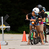 Zareanna Chandler, 9, of New Albany, looks both ways at a railroad crossing on the bicycle safety rodeo course at the Griffin Center on Friday afternoon in New Albany. About 20 participants from the Riverside, Parkview and Griffin Street recreation centers learned about traffic rules and general bicycle safety in the Kosair Children's Hospital event through the New Albany Department of Parks and Recreation. Staff photo by Christopher Fryer