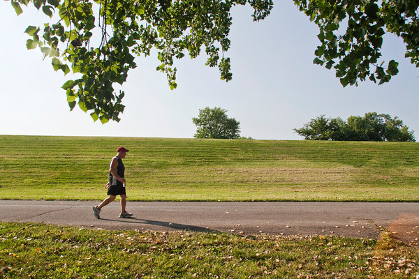 Tom Pickett, of New Albany, walks along West Water Street as part of a 101 mile Memorial Day weekend walk on Saturday evening in New Albany. Pickett hopes his walk will help inspire others to start walking just like his wife, Rosaland, inspired him. Staff photo by Christopher Fryer