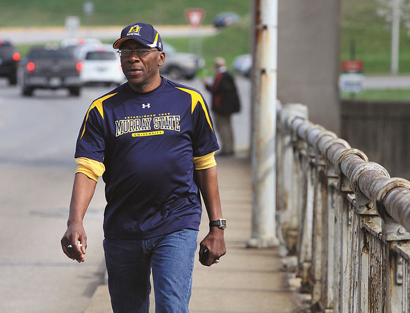Former Murray State University basketball player Lamont Sleets walks across the Clark Memorial Bridge from Jeffersonville Thursday to watch the Murray State and Colorado State game at the KFC Yum Center.  Staff photo by C.E. Branham