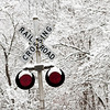 Snow and ice cling to a railroad signal along Corydon Pike in Floyd County on Saturday afternoon. Staff photo by Christopher Fryer