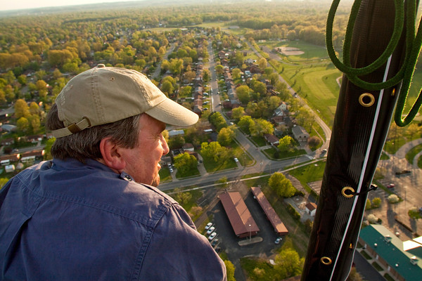 Balloon pilot Jerry Copas looks out over southern Indiana during a hot air balloon flight on Monday evening. He will be competing in the Kentucky Derby Festival Great Balloon Race this week. Staff photo by Christopher Fryer