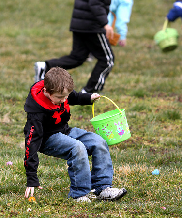 Nathan Morrow snags an egg at the Utica Community Center Easter egg hunt Saturday morning. Staff photo by C.E. Branham
