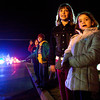 Kelcie Moore, 7, right, and Trinity Weatherbee, 8, both of Charlestown, look on as floats move down Market Street during the inaugural Charlestown Christmas Parade on Saturday evening. Hundreds of people lined the streets to watch floats from local organizations and businesses. Staff photo by Christopher Fryer