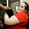 Katie Brison, of Jeffersonville, and her friend Ortega Crutcher, left, of Louisville, love on a cat while volunteering at the JB Ogle Animal Shelter in Jeffersonville on Wednesday afternoon. Staff photo by Christopher Fryer