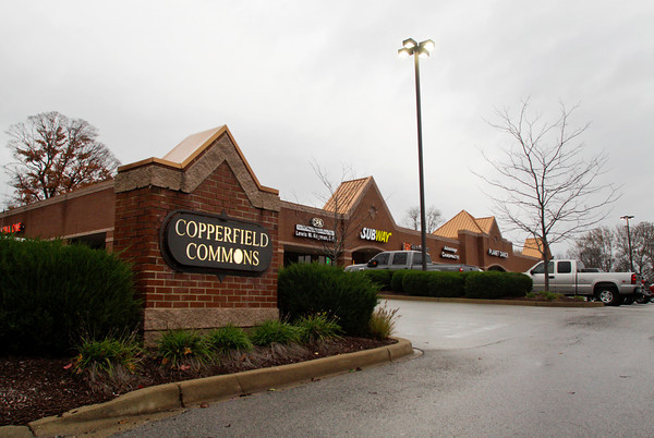 A sign for Copperfield Commons shopping center sits on its location in Georgetown on Tuesday evening. Staff photo by Christopher Fryer