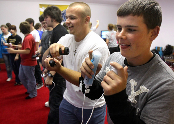 Henryville High School students Cameron Hardesty, foreground, and Taylor Green box on a Wii system in their physical education class at the Mid-America Science park in Scottsburg. Lacking outdoor recreation areas, teacher John Bradley opted for a virtual gym class. The gaming systems and televisions were bought with donations from Eastern High School in Louisville. Staff photo by C.E. Branham