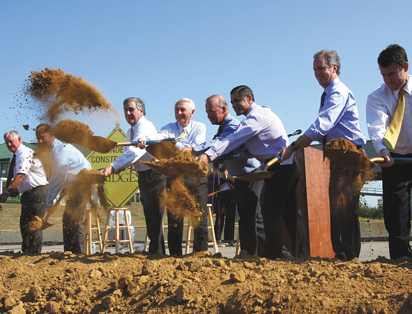 Indiana and Kentucky officials let the dirt fly at a ceremonial groundbreaking for the East End Bridge Crossing Thursday in Jeffersonville. Staff photo by C.E. Branham