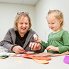 Sheryl Dant, Jeffersonville, helps her granddaughter Elin Collins, 3, Memphis, construct a Native American headband in the craft room during the Gobbler Games at the Clarksville Community Center on Saturday morning. About 50 children between the ages of five and 12 participated in other games and crafts at the annual event put on by the Clarksville Parks Department and the Optimist Club of Clarksville. Staff photo by Christopher Fryer