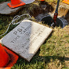 The marker for a Duke Energy time capsule, buried in 1987, sits next to the hole before the capsule was removed during a ceremony at the company's Clarksville location on Wednesday morning. This year also marks the company's 100th anniversary. Staff photo by Christopher Fryer