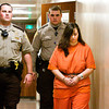 Lisa M. Shuler is escorted down a hallway following a hearing in Superior Court No. 3 of the City-County Building in New Albany on Thursday afternoon. Staff photo by Christopher Fryer