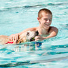 Jacob Searcy, Jeffersonville, and his yellow lab, Cheyenne, play in the main pool during the seventh annual Pooch Plunge at the Jeffersonville Aquatic Center on Saturday afternoon. This event, along with the children's goldfish run earlier in the day, were the final activities at the center for the season. Staff photo by Christopher Fryer