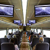Passengers ride along as the engineer's point-of-view is displayed on monitors overhead on the Norfolk Southern Operation Lifesaver Whistle-Stop Train during a train tour to promote highway-rail and pedestrian safety on Friday. Staff photo by Christopher Fryer