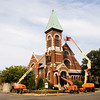 Crews with Schickel Masonry Restoration, out of Floyds Knobs, and Scott's Painting, out of Louisville, work on the exterior of St. John United Presbyterian Church along East Elm Street in New Albany on Thursday afternoon. The Schickel crew will be cleaning the entire exterior of the structure, as well as taking care of any brick and mortar repairs. Staff photo by Christopher Fryer