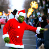 The Grinch visits with parade watchers during the Light Up the Holidays Parade Saturday evening in downtown Jeffersonville. Staff photo by C.E. Branham