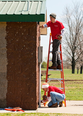 Northside Christian Church volunteers Ron, above, and Malvery McKimm, both of New Albany, paint a restroom during the cleanup day at Sam Peden Community Park in New Albany on Saturday morning. Staff photo by Christopher Fryer