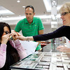 Manager Wendie Canavan, right, helps Trish Gilles look at a ring with a loupe while she and her husband Darrell shop for a replacement wedding/anniversary ring at Genesis Diamonds in Louisville, Ky on Friday morning. Gilles lost her wedding/anniversary ring when her family's home in Henryville was destroyed during the March 2 tornadoes. Staff photo by Christopher Fryer
